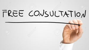 Man writing the words - Free Consultation